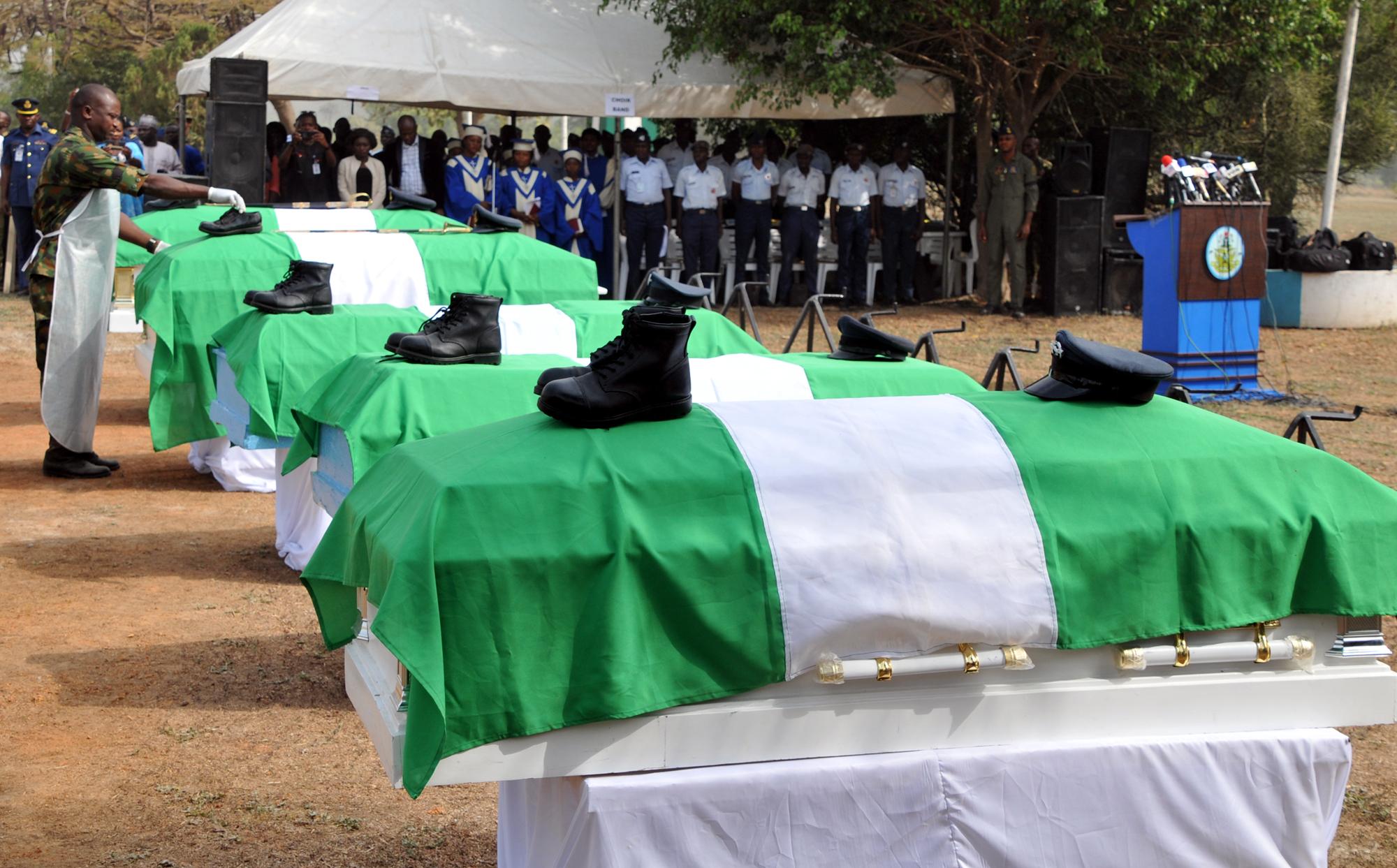 Burial Of Air Force Plane Crash Victims Begins